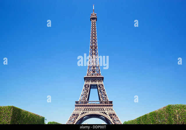 Summer view of the Eiffel Tower against a blue sky, Paris - Stock Image