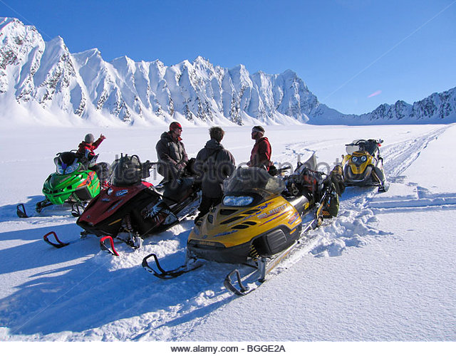 Alaska, Valdez, Heiden Glacier, The Books. A group of snowmachine skiers decides where to ski next. - Stock Image