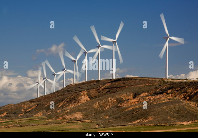 A row of nine wind turbines turning on a hill near Zaragoza, Spain - Stock Image