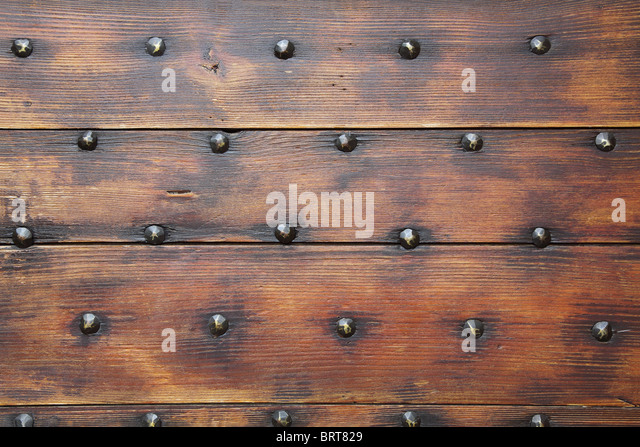 Wooden surface with nails, a background - Stock-Bilder