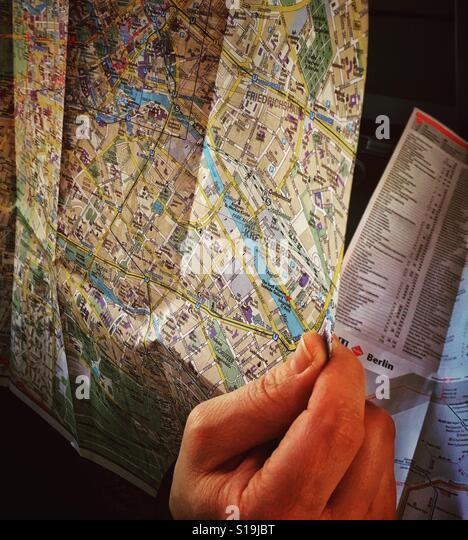A hand holding a city map of Berlin , Germany,Europe - Stock Image