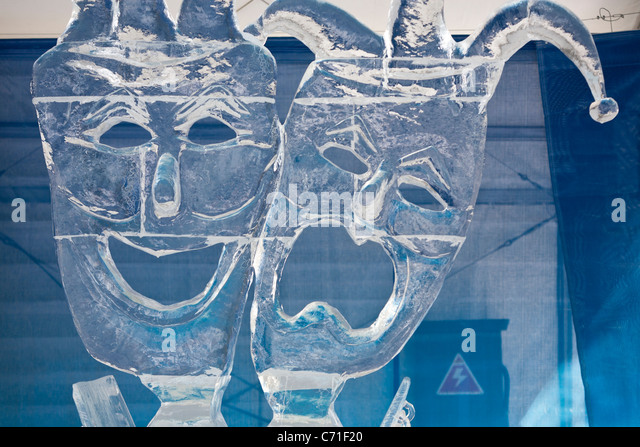 Theatre Masks: comedy and Tragedy in ice. Two masks carved in ice form part of ice carving competition at Ottawa's - Stock Image