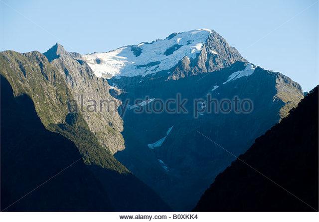 Mountains above Milford Sound, Fjordland, South Island, New Zealand - Stock Image