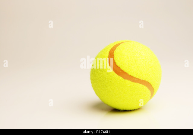 Tennis ball on white - Stock Image