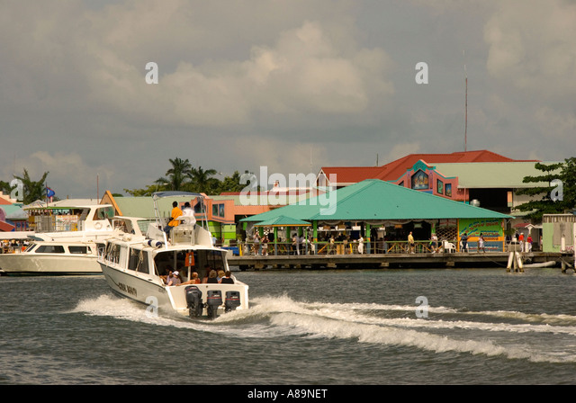 Belize City Belize Tourism Village cruise shops ferry tender - Stock Image