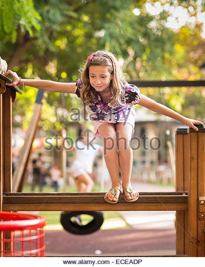 Spain, Valencia, Girl (6-7) clambering jungle gym - Stock-Bilder