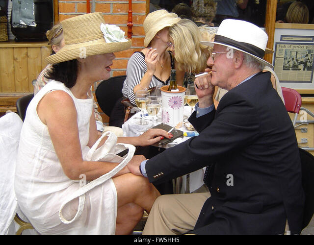 Diners in period costume for Bloomsday, June 16th, outside Caviston's restaurant, Glasthule, Co. Dublin, Ireland, - Stock Image