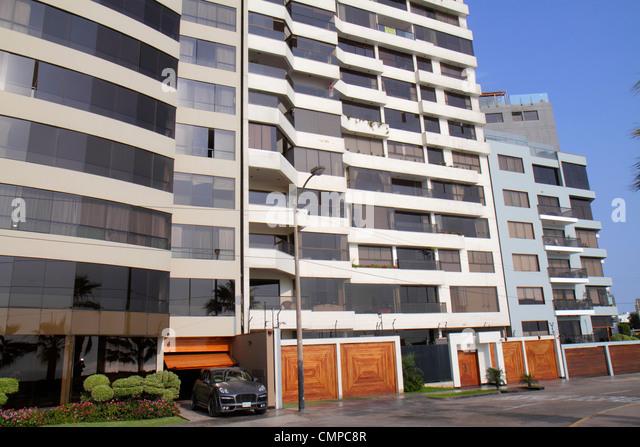 Peru Lima Miraflores Malecon de la Reserva upscale neighborhood oceanfront apartments flats condos high-rise building - Stock Image