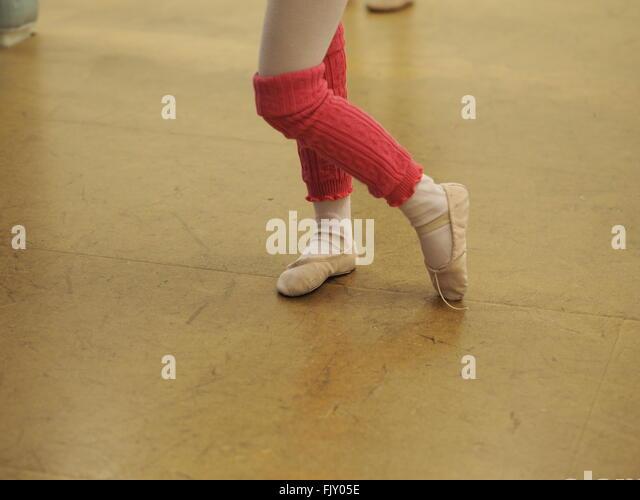 Low Section Of Ballet Dancer Dancing On Floor - Stock Image