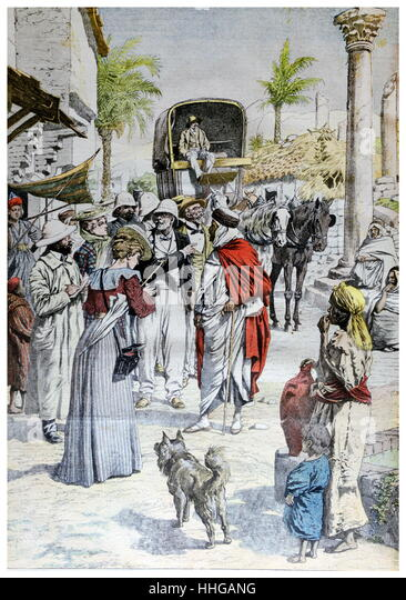 French Illustration showing a caravan of French administrative staff arriving at a town in the French colony of - Stock Image
