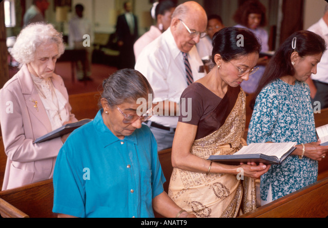 New Jersey Teaneck United Methodist Church Asian women pray service religion Christian bible belief - Stock Image