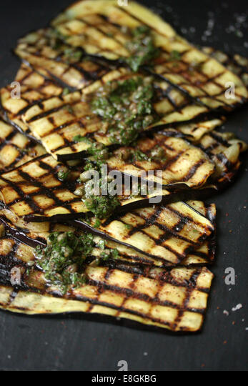 Grilled Eggplant with sumac, capers and mint - Stock Image