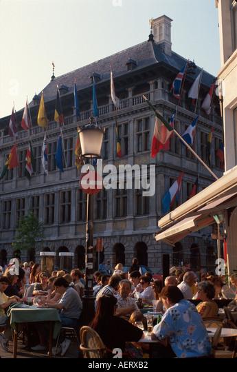 Belgium Antwerp Groen Place outdoor café alfresco dining international flags buildings architecture - Stock Image