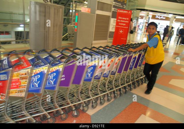 Bangkok Thailand Suvarnabhumi International Airport BKK terminal concourse gate area rental luggage carts Asian - Stock Image