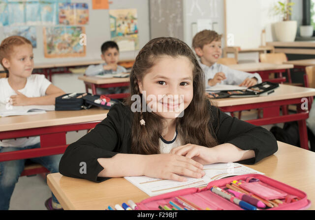 School students studying in classroom, Munich, Bavaria, Germany - Stock Image