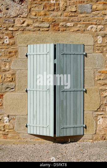 Half closed shutter on a house near St Antonin Noble Val, France - Stock Image