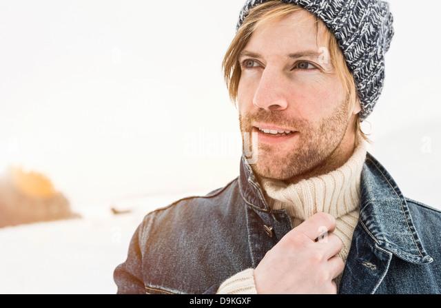 Portrait of man wearing knit hat - Stock Image