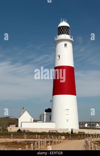 Rear view of the large white and red lighthouse on Portland rocks in Weymouth - Stock Image