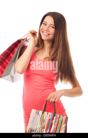 Portrait of a beautiful young woman holding shopping bags, isolated on white - Stock Image
