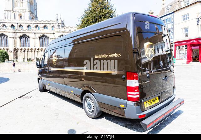 UPS delivery van vehicle delivering parcels parked service services logistics UK England - Stock Image