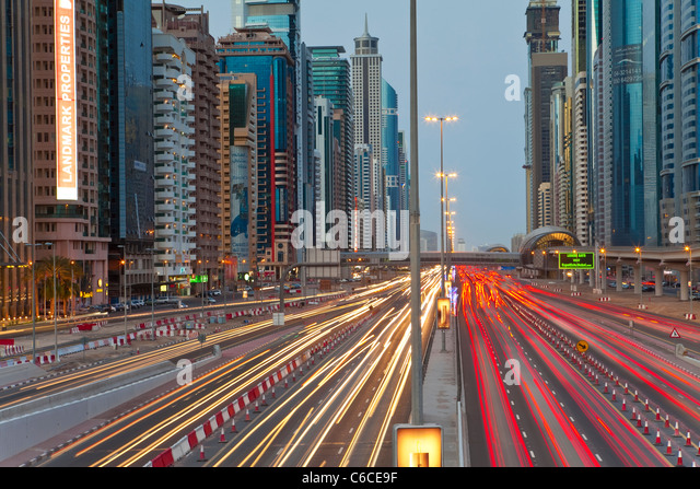 United Arab Emirates, Dubai, Sheikh Zayed Road, traffic and new high rise buildings along Dubai's main road - Stock Image