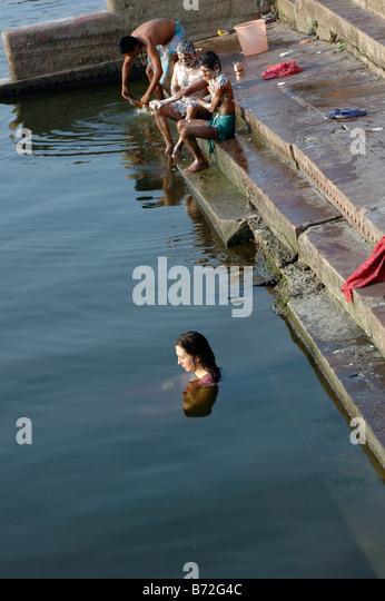 India Uttar Pradesh Varanasi Caucasian tourist in the Ganges River - Stock-Bilder