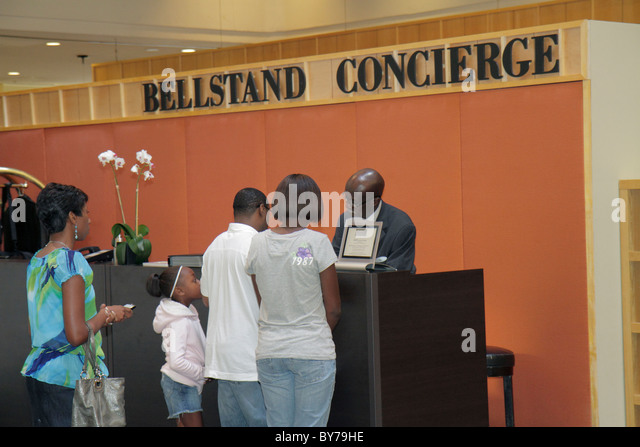Atlanta Georgia Atlanta Hyatt Regency hotel lodging business chain hospitality lobby concierge bellstand Black man - Stock Image