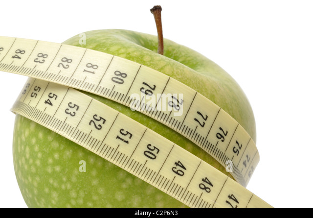 Diet concept - apple and measuring tape isolated on white - Stock Image