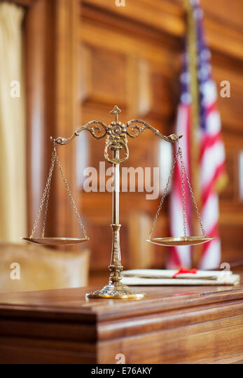 Scales of justice on the judge's bench - Stock Image