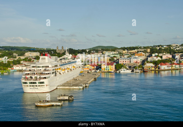 Antigua St. Johns Caribbean cruise port dock above with moored ship and cityscape in bright colors - Stock Image