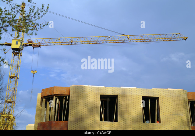 Building of the brick house with the elevating crane, Moscow Region, Russia - Stock Image