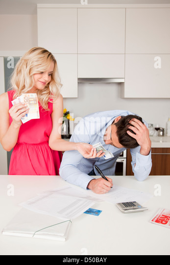 Man borrowing money - Stock Image