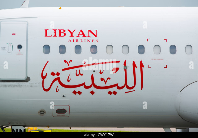 A close up of the Libyan Airlines logo on the fuselage of a passenger aircraft (Editorial use only) - Stock Image