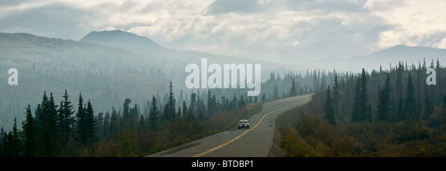 Car driving through a thick haze of wildfire smoke on the park road in Denali National Park & Preserve, Alaska - Stock Image