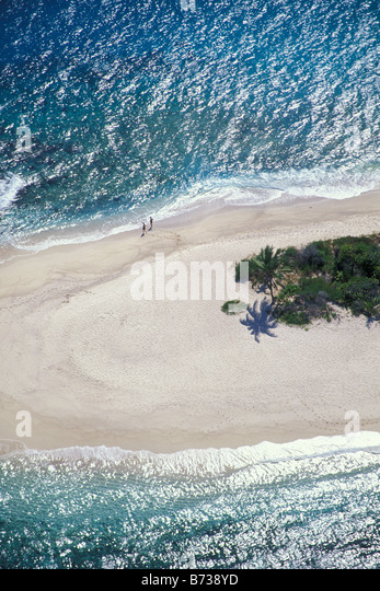 Expanse of sandy beach and some vegetation on small unihabited islet in The Virgin Islands caribbean - Stock Image