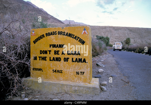 Stone sign, humorous and poetic invitation to drive carefully, Nubra Valley, Ladakh, Indian Himalayas, Jammu and - Stock Image