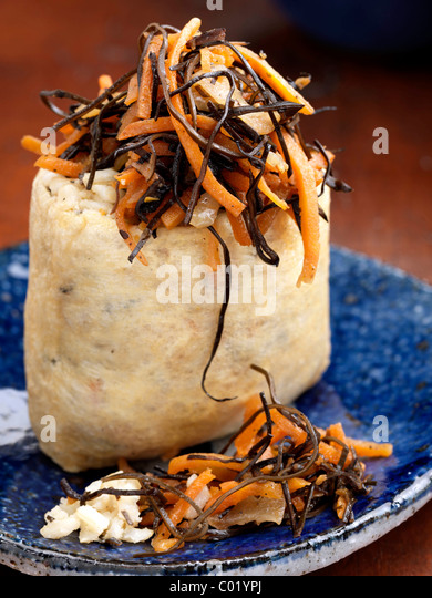 Individual portion rice pouch with carrot salad - Stock Image