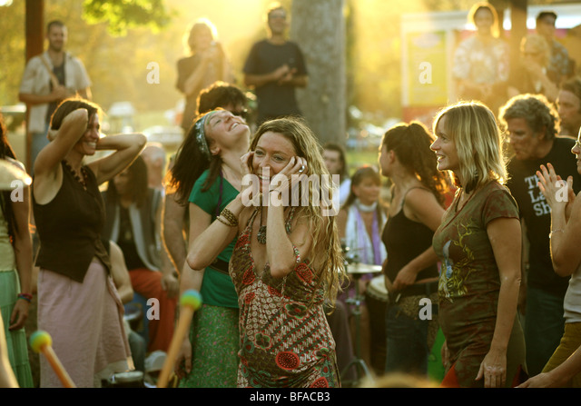 Women dancing to drums at The Channon near Byron Bay Australia - Stock Image
