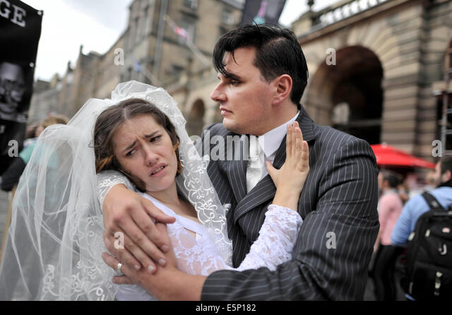 Edinburgh, Scotland, UK. 4th Aug, 2014. Edinburgh's Fringe Festitival performers from The Pity gather on the - Stock Image
