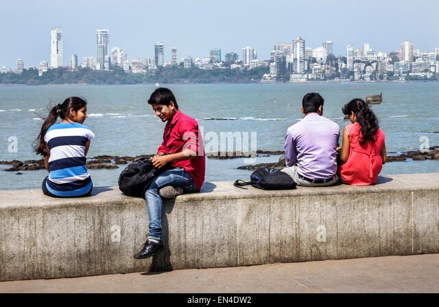 Mumbai India Asian Churchgate Marine Drive Back Bay Arabian Sea teen boy girl couple romantic Malabar Hill skyline - Stock Image