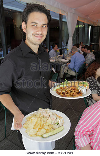 Maryland Baltimore Baltimore Museum of Art Gertrude's Restaurant chef John Shields man waiter plate lobster - Stock Image