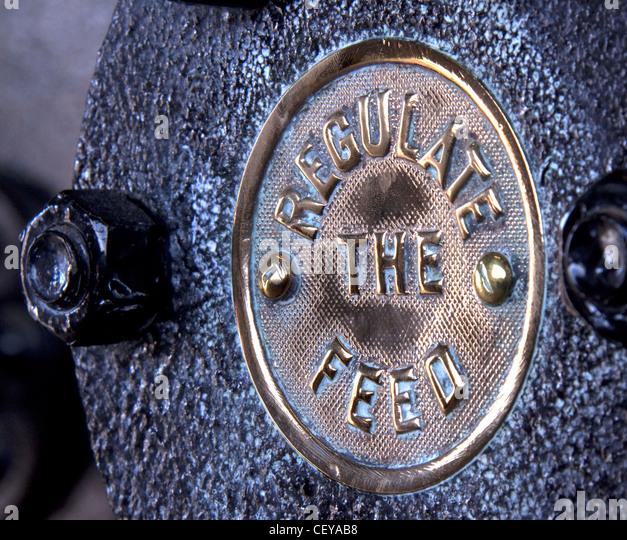 Regulate The Feed sign from a canal dock steam engine. - Stock Image