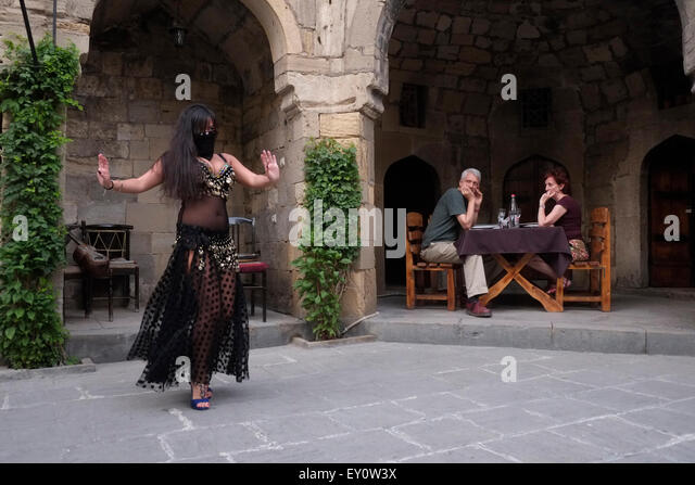 A belly dancing entertainment in a restaurant in the city of Baku capital of Azerbaijan - Stock Image