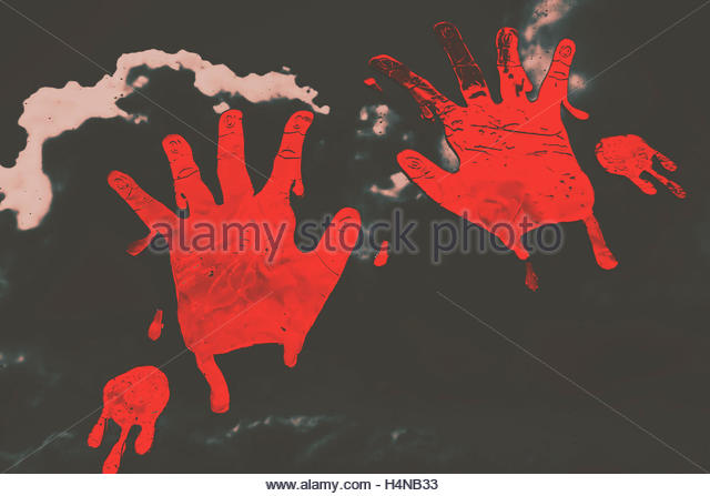Eerie dark background on two red bloody hand prints blotched on the inside of a house window. Trace of a serial - Stock Image