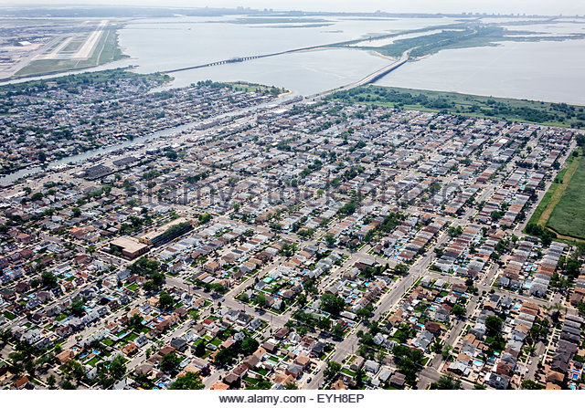 New York Queens John F. Kennedy International Airport JFK aerial approach Jamaica Bay Howard Beach - Stock Image
