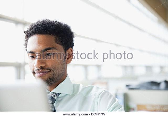 Businessman looking at computer screen - Stock Image