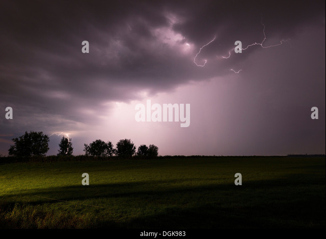Thunderstorm raging over night sky - Stock Image