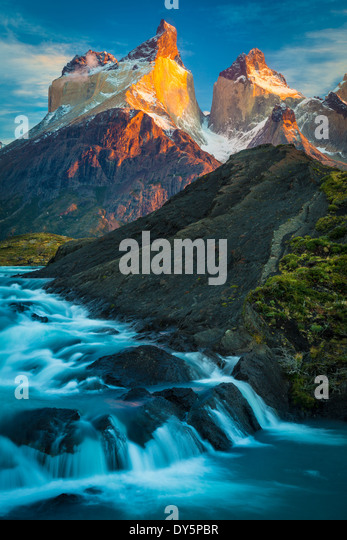 Los Cuernos towering above a cascade near Lago Nordenskjold in Torres del Paine, Chilean part of Patagonia - Stock Image