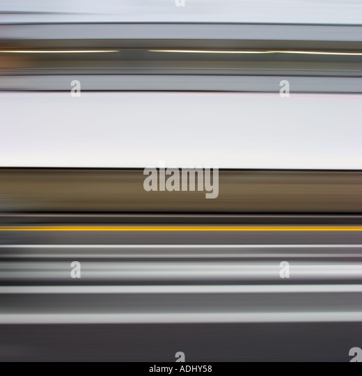 blurred grey and yellow abstract on motorway - Stock Image