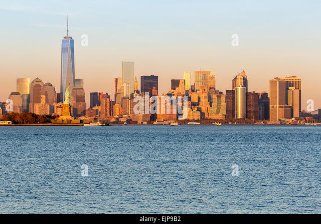 Statue of Liberty, One World Trade Center and Downtown Manhattan across the Hudson River, New York, United States - Stock Image